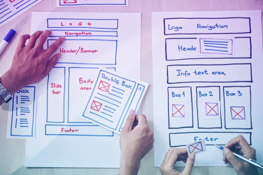 Crop colleagues creating website prototype